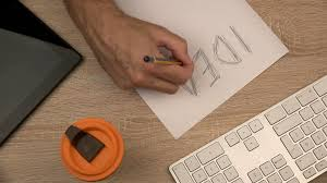 Paper With Writing Graphic Designer Writing Idea On Piece Of Paper With Felt Pen