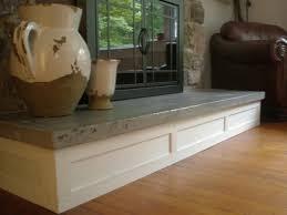 concrete hearth and custom mantel traditional living room