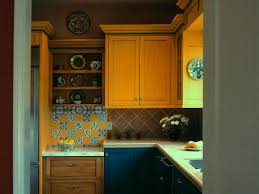 cheerful yellow themed kitchen with ultra modern island with