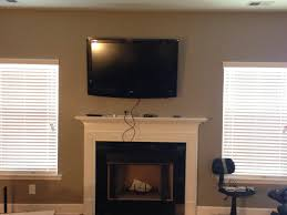 decoration interesting mounting a tv over a fireplace with window