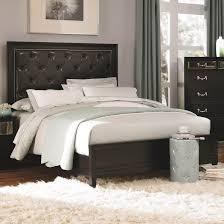 black wooden bed frame with tufted leather headboard and white