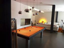 black wooden pool dining table with orange counter top plus flour
