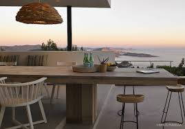 wooden outdoor dining table sea views terrace modern house in