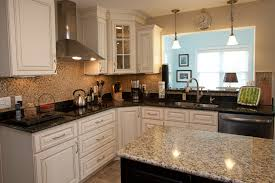 White Kitchen Cabinets With Black Granite Countertops by Furniture Dark Yorktown Cabinets With Ventahoods And Omicron