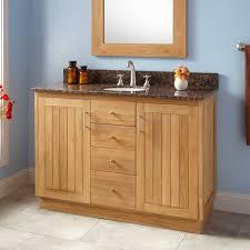 modern black gloss bathroom vanity with round steel knob handles