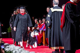 Have dog  will succeed  York U grad walks through convocation by