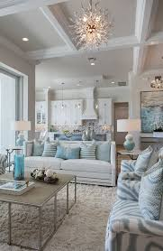 living room white chaise lounges gray benches gray sofa white