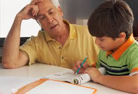 ADHD in Children  Problems  Symptoms  and More in Pictures WebMD man helping his boy do his homework