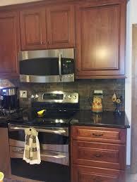 Kitchen Backsplash Cherry Cabinets by Cherry Cabinets Tan Brown Granite Counter Copper Rust Slate