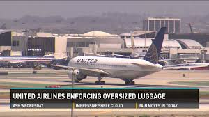 united airlines charging extra fees for oversized carry on luggage