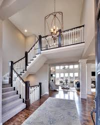 entry curved staircase open floor plan overlook from the upper
