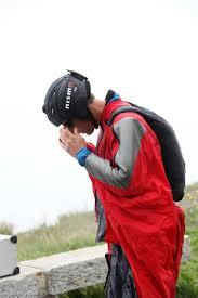 nissan 370z nismo youtube nissan cars news 370z nismo races wingsuit man in swiss alps