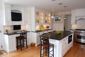 decorating chic white wooden kitchen cabinet with black corian vs