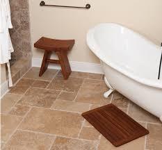 bathroom round teak bath mat on travertine tile floor for modern