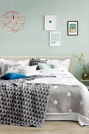 mint watery blue green walls grey accents comfy bed i like the