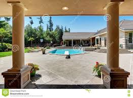 modern backyard with swimming pool in american mansion stock photo