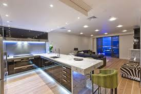 exquisite kitchen design with green chairs and backsplash tile