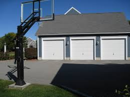 3 Car Garage There Is His Pro Dunk Platinum Basketball System In Front Of His 3