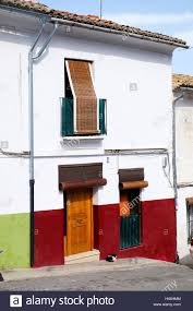 roller blinds over the windows and doors of a typical spanish