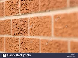 a modern brick wall of a modern new house with minimum depth of