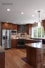 Kitchen Tv Under Cabinet by Best 25 Cherry Kitchen Cabinets Ideas On Pinterest Traditional