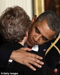 President Barack Obama embraces Rose Mary Sabo-Brown (left and right) - article-2145597-13206261000005DC-713_306x381