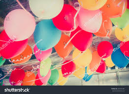 colorful balloons floating on ceiling party stock photo 269346380