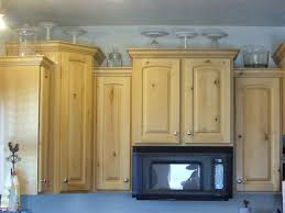 Pic Of Kitchen Cabinets by Decorating The Top Of The Kitchen Cabinets Organize And Decorate