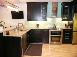 White Kitchen Cabinets With Black Granite Countertops by Tiny Counter And Bath Island By Mocha Tile Backsplash White