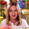Jackie Evancho sits in front of a mountain of gifts in her new video for ... - jackie-evancho-believe-video