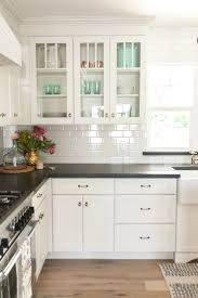 best ideas about dark kitchen countertops pinterest white shaker cabinetry with glass upper cabinets featured rafterhouse pilot episode subway tile backsplashkitchen