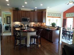 tiny dark kitchen cabinets with light island mixed patterned kitchen