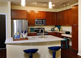 nice glass pendant lamps over white marble countertops kitchen