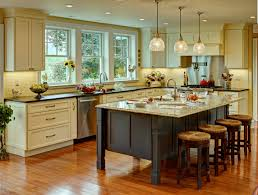wood and stone kitchen with gourmet range and large island with