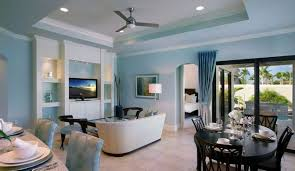 blue walls and light gray furniture in living room for the home