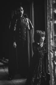 i take pictures of my husband and daughter dressed up for a spooky