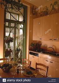 sycamore wood units in townhouse kitchen dining room with green