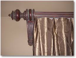 double tuck top pleated drapery with wood poles brackets and