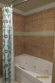 new tile shower with green glass tile inlay in girls bathroom