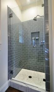 best 25 small tile shower ideas on pinterest small bathroom ice glass subway tile in shower i like the dark hue would
