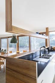 energy efficient home charms with a distinct roof and an earthy