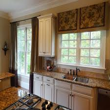 stunning window treatment for kitchen with sink and granite
