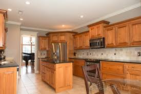 behr perfect taupe walls maple cabinets tile floor white trim