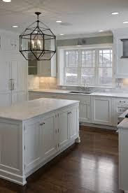 White Kitchen Cabinets With Black Granite Countertops by 25 Best Dark Cabinets And Dark Floors Ideas On Pinterest Dark