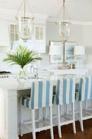 Coastal Dining Room Ideas by Coastal Dining Room With Beachy Blue Dining Chairs Hgtv