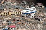 Japan tsunami and earthquake: Rescuers pick their way through.