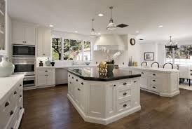 antique white kitchen cabinets with black granite countertops and