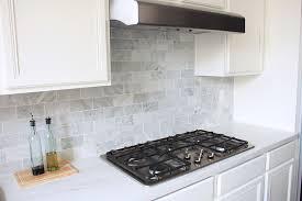 The Kitchen Backsplash Is Done NicelyVia Made By Girl - Carrara tile backsplash
