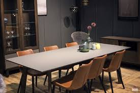 black chair cabinets and pendant lights white rounded dining table