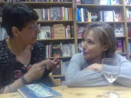 Here is Miriam at her launch talking to her agent Eve White  That is my copy of the book she is about to sign on the table